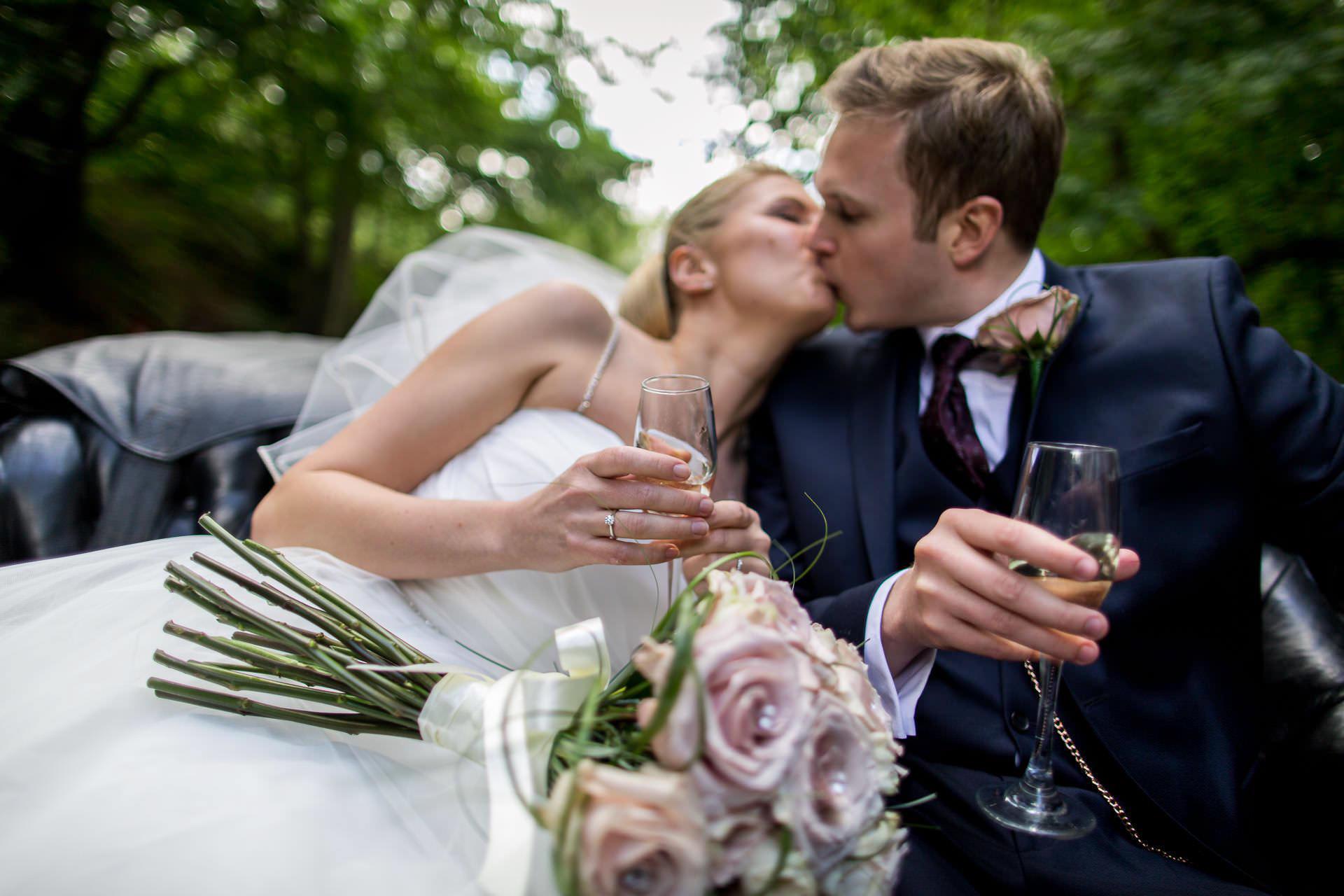 Wotton House wedding bride kisses the groom