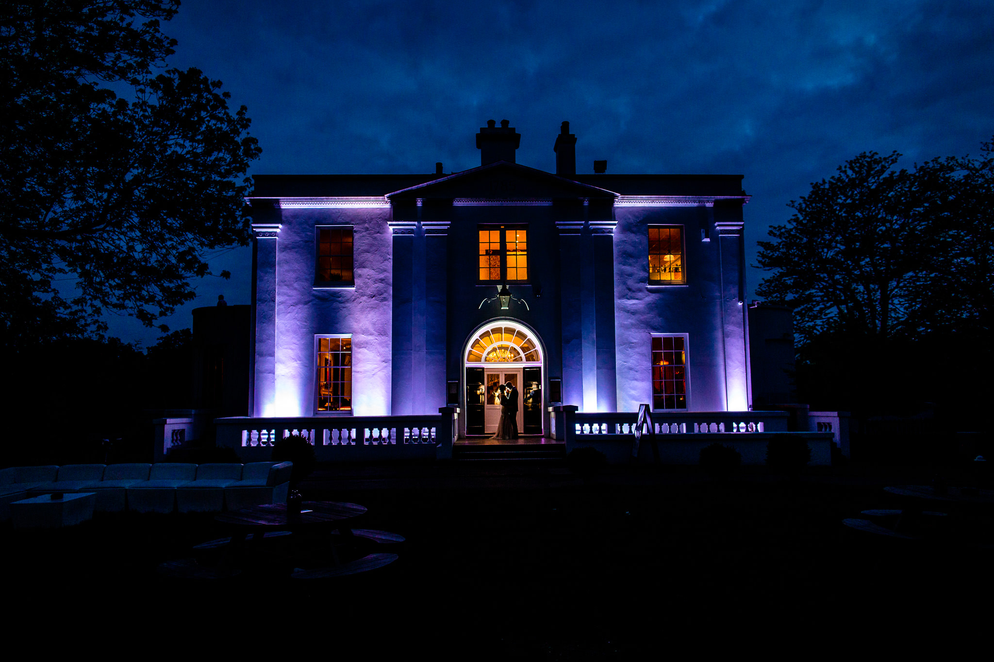 Belair House Dulwich Wedding Photographer couple posing in front of the venue