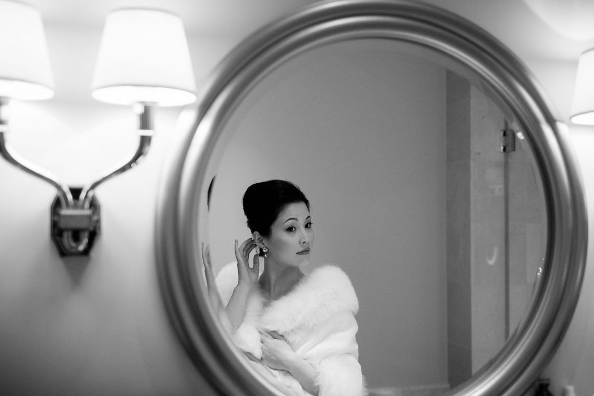 Chinese bride looking in the mirror