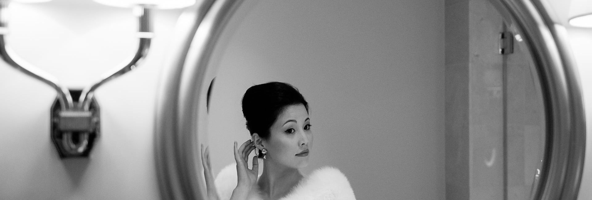 Chinese wedding bride looking in the mirror