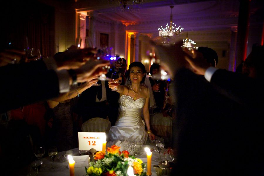 Chinese Wedding photo of Bride and groom drinking cognac with their guests by the table