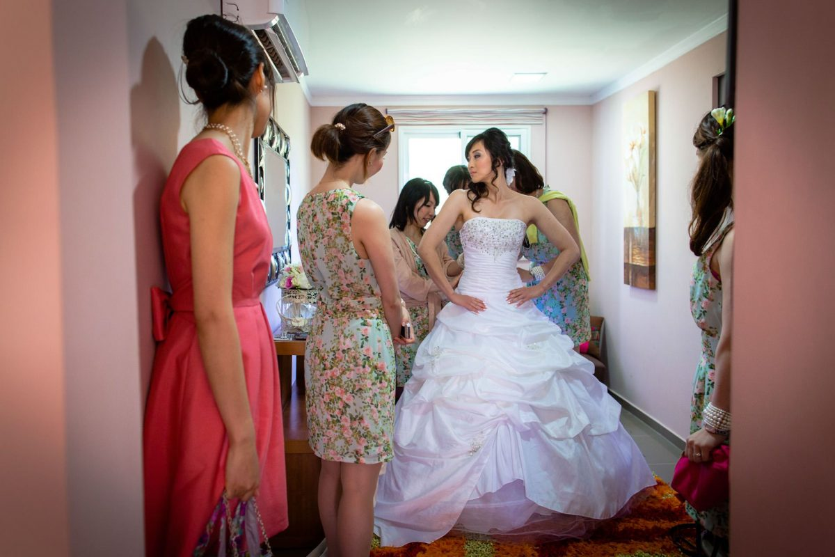 Japanese bride getting ready in her wedding dress for her destination wedding in Portugal