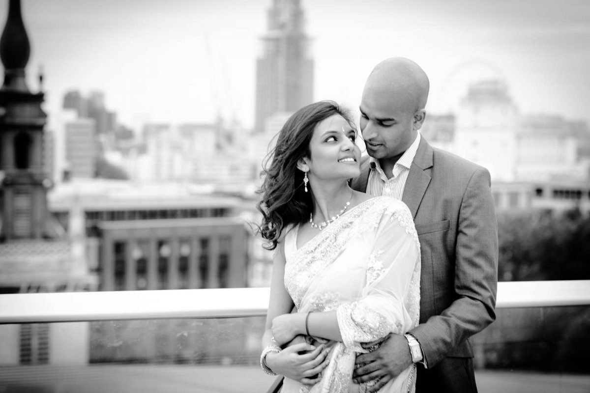 Engagement couple in front of St Pauls Cathedral in London