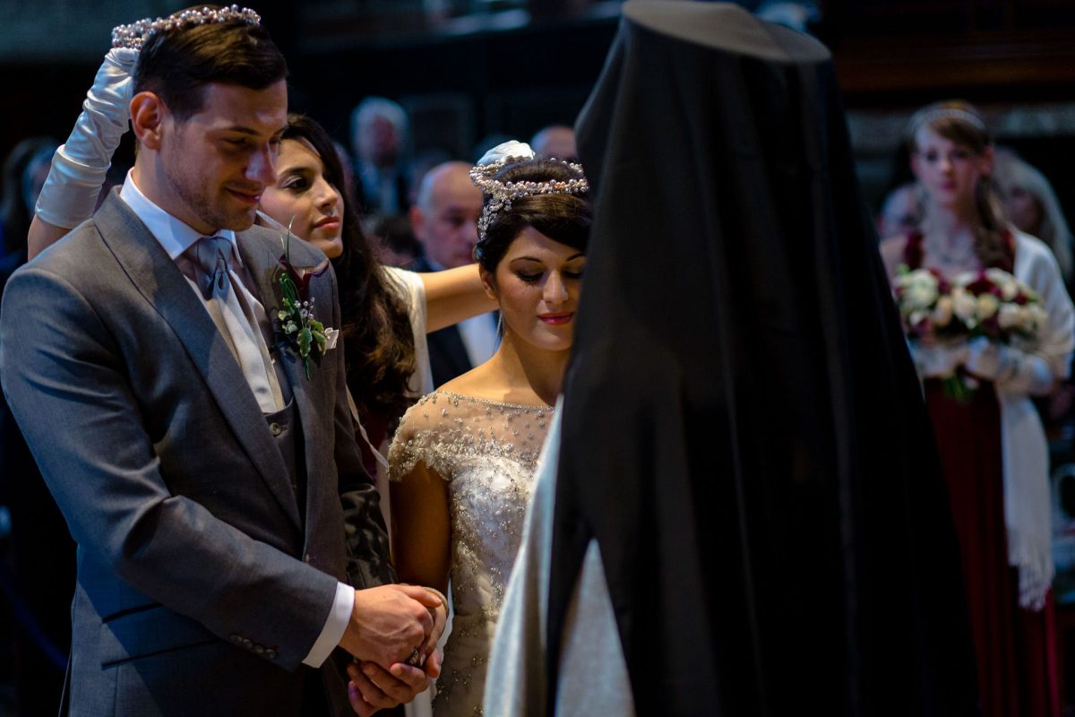 Brides sister swapping the crown in greek church
