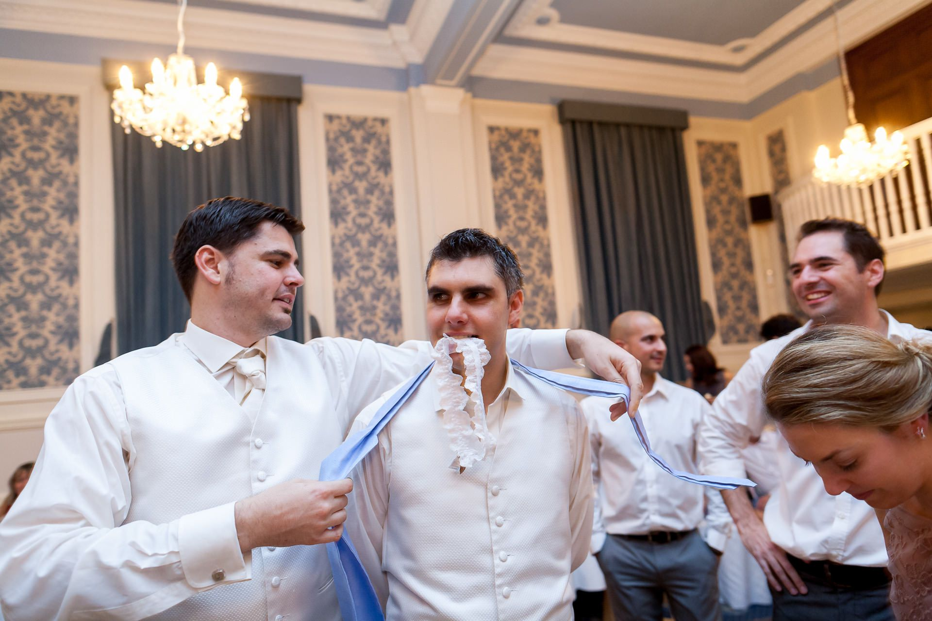 Greek Wedding groom hold the garter in his mouth
