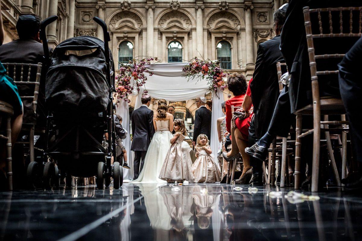 Bride and Groom under Chuppah during Jewish wedding ceremony