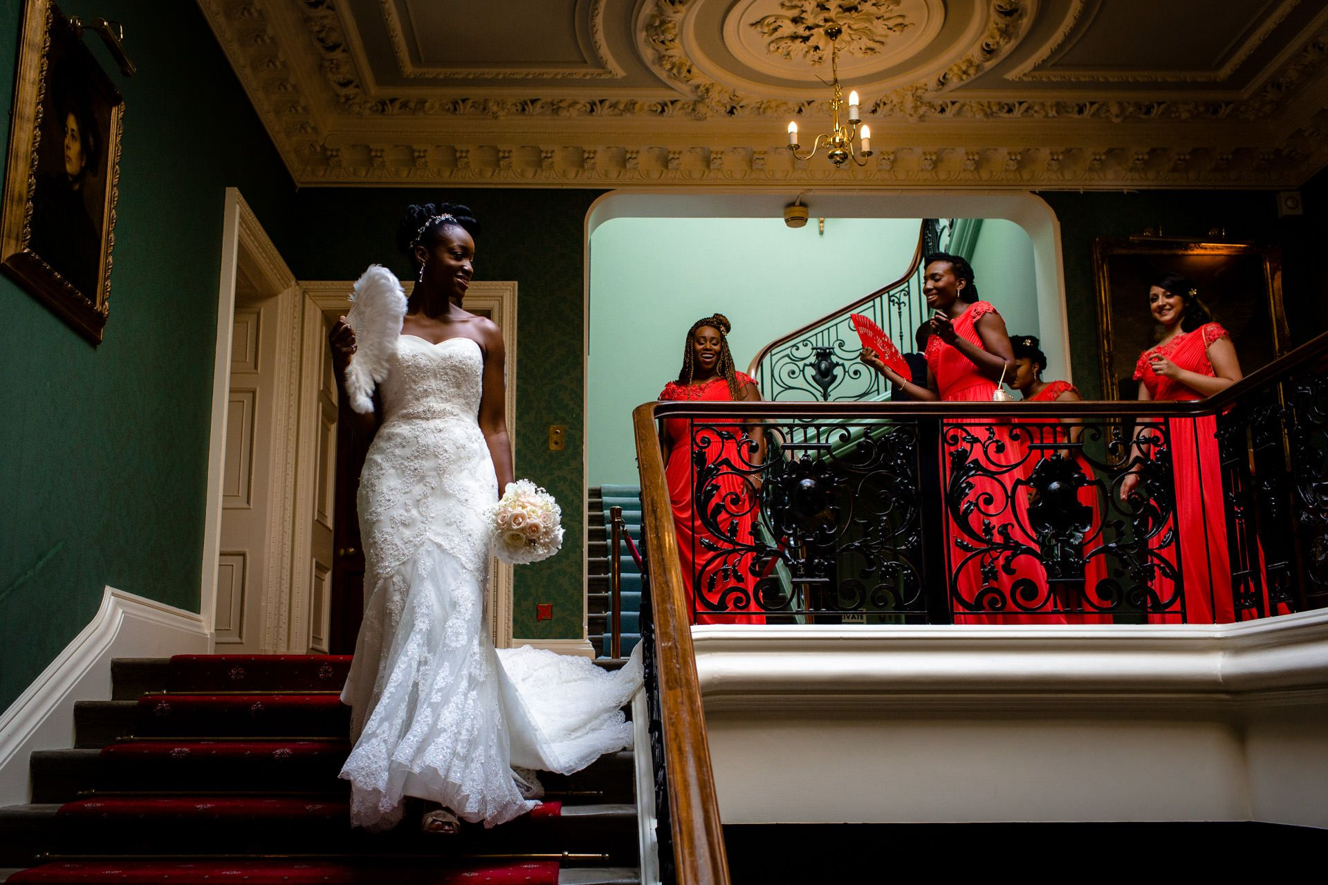 Nigerian wedding bride walking down the stairs before the ceremony