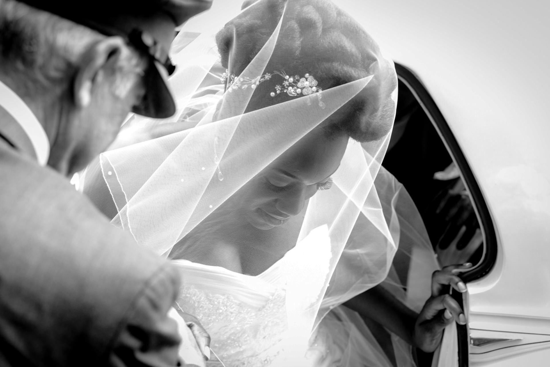 Nigerian wedding photo of bride getting of the car