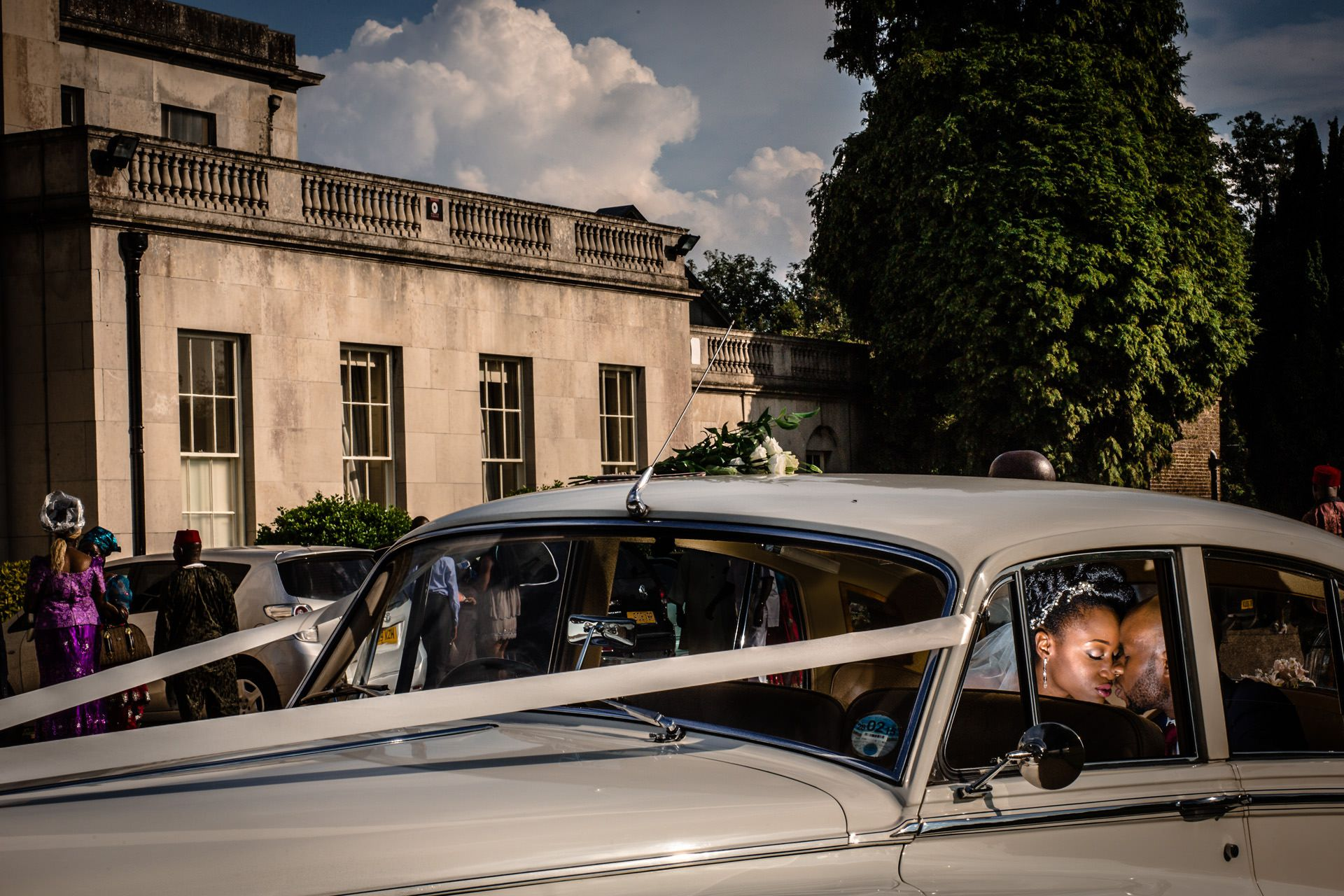Nigerian wedding Bride and groom in the car during the couple session