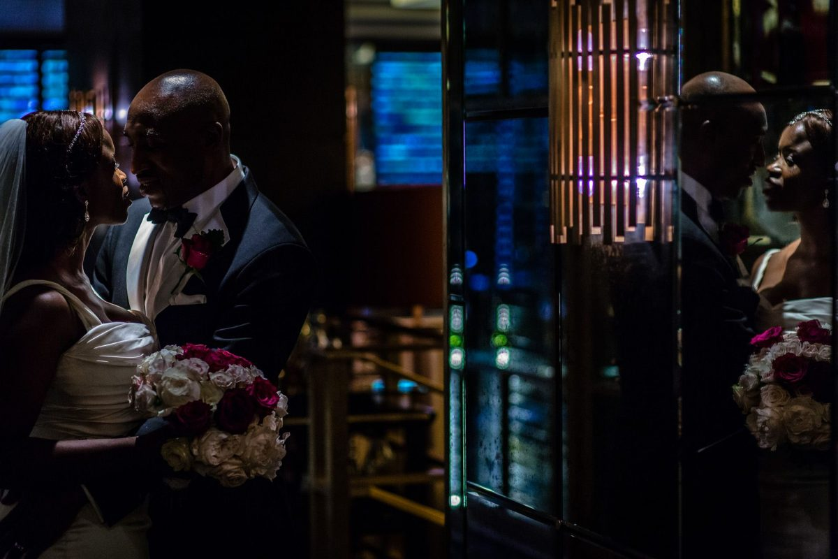 Nigerian bride and groom having a private moment in the hotel's bar