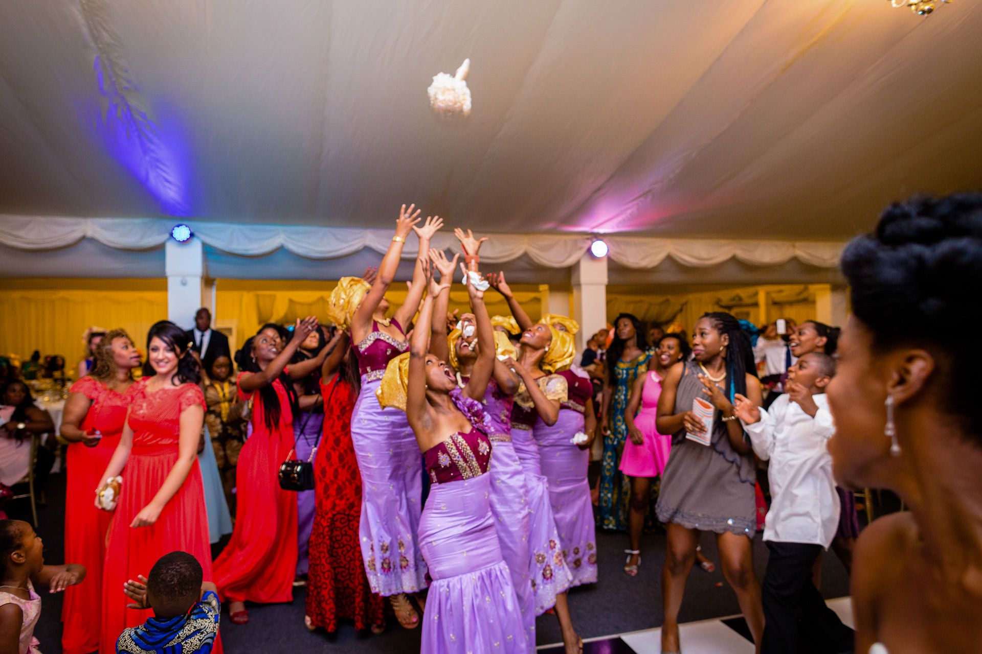 Nigerian wedding bride throwing a bouquet