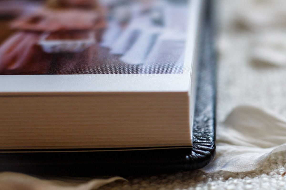 the edge of the wedding album in black leather cover