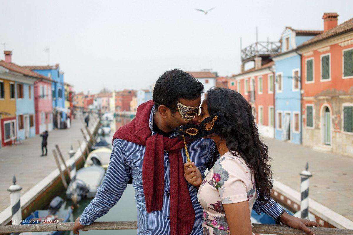 the couple with venetian mask in Burano island