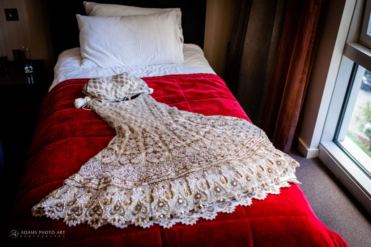 brides dress on the bed