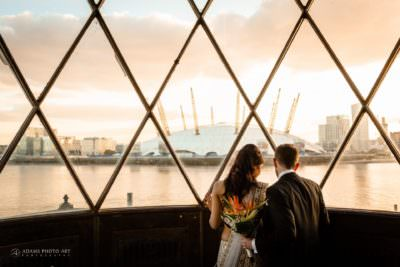bride and groom overviewing their wedding venue and 02 arena at trinity buoy-wharf-