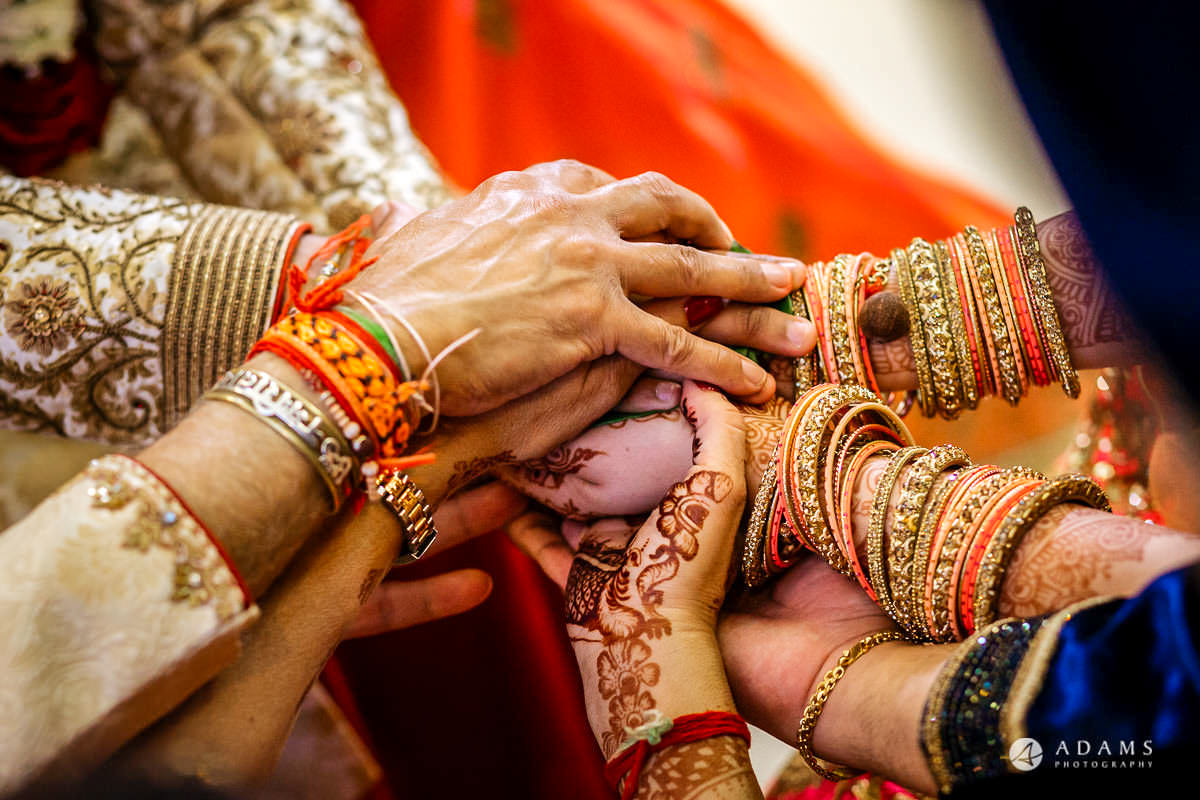 asian wedding ceremony family holds hands