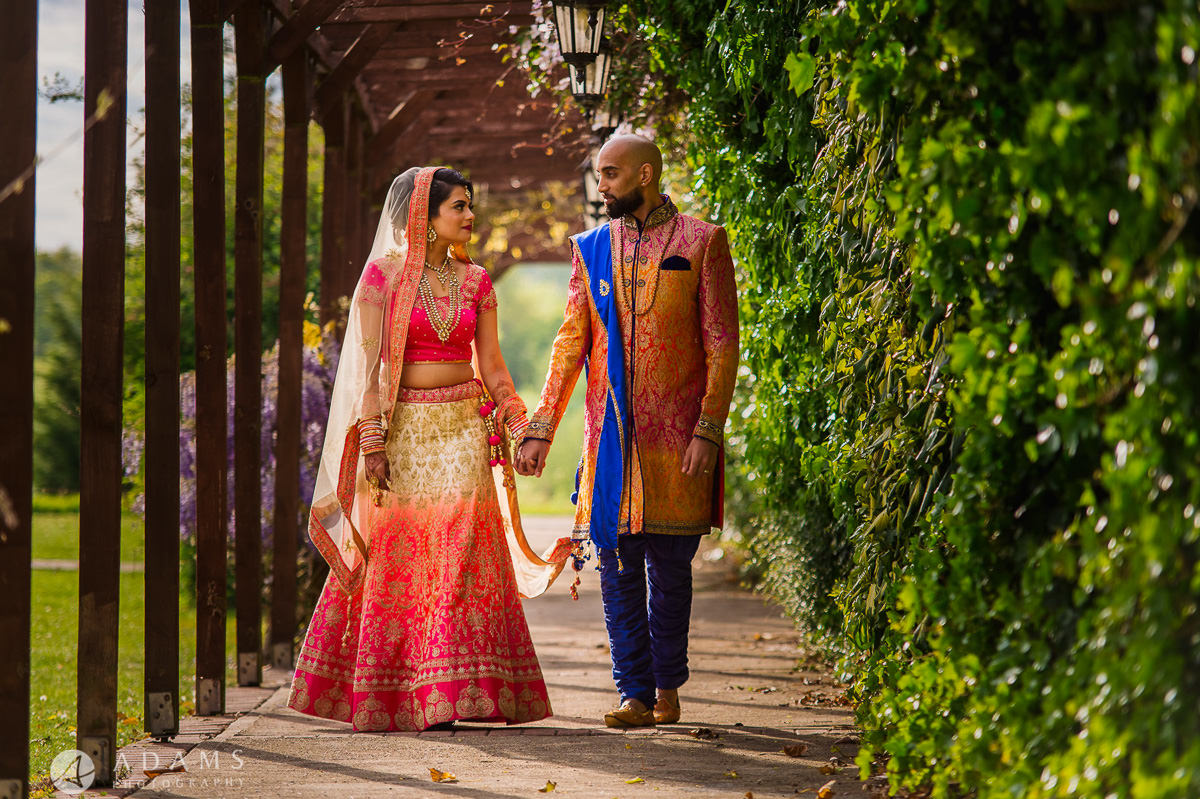 Asian Wedding Photographer London couple walking