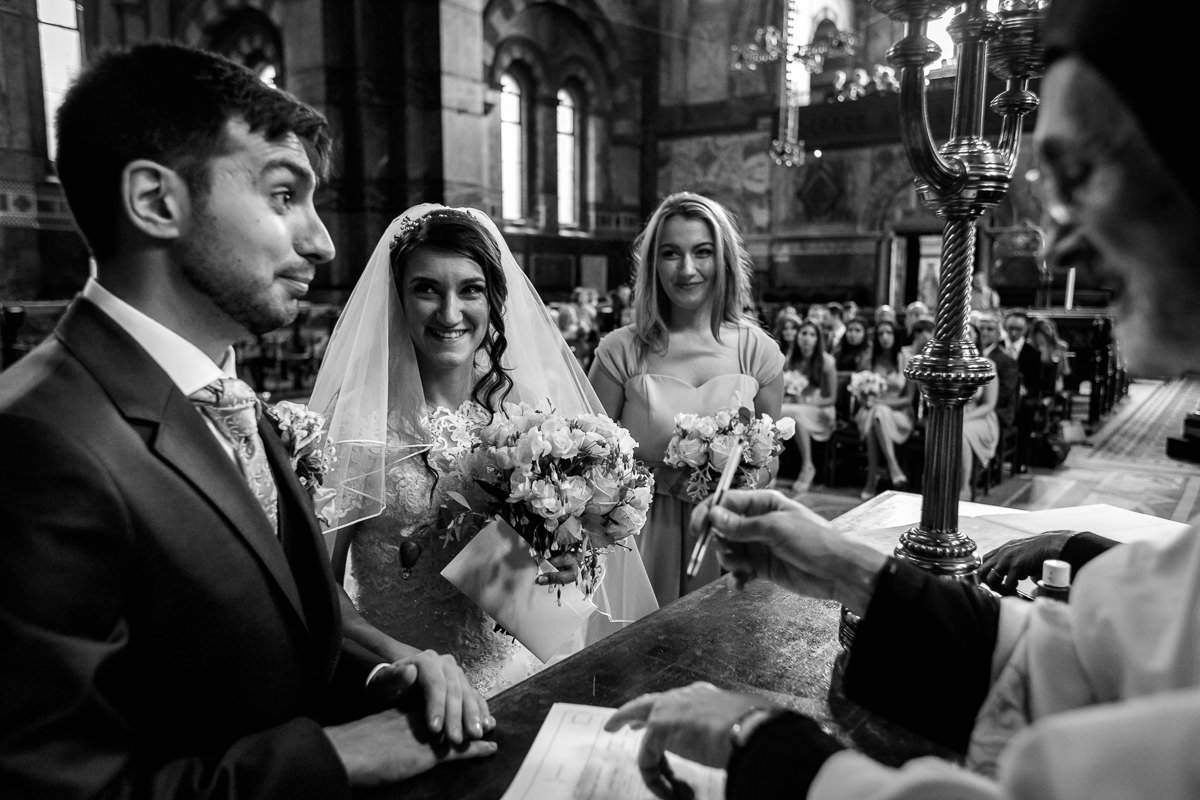 Greek Wedding Photographer signing the registrar