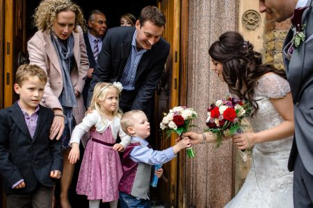 Greek Wedding Photography kids hand in the flowers