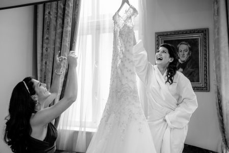 Greek Wedding Photo of bride hanging her wedding dress