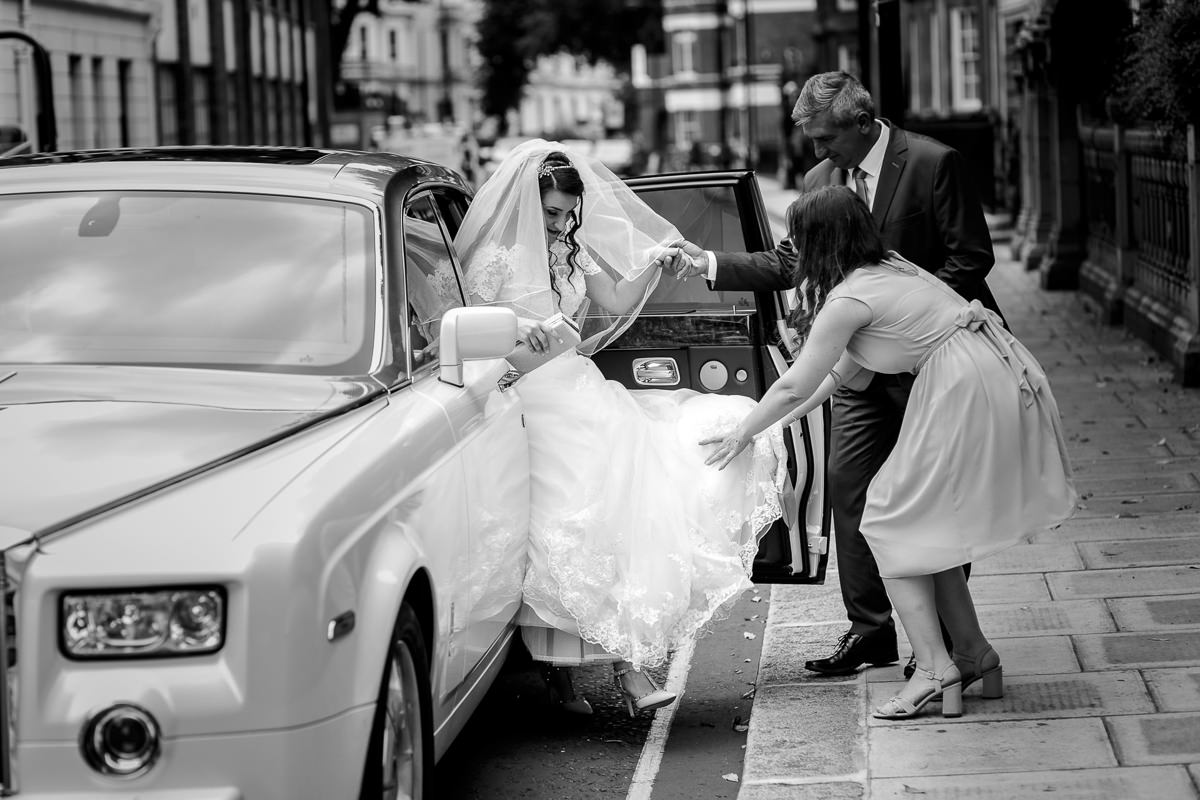 Greek Wedding Photo of bride getting out of the car