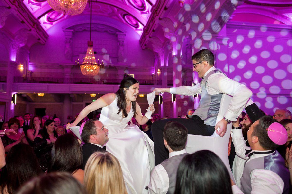jewish wedding photographer chair dance during hora