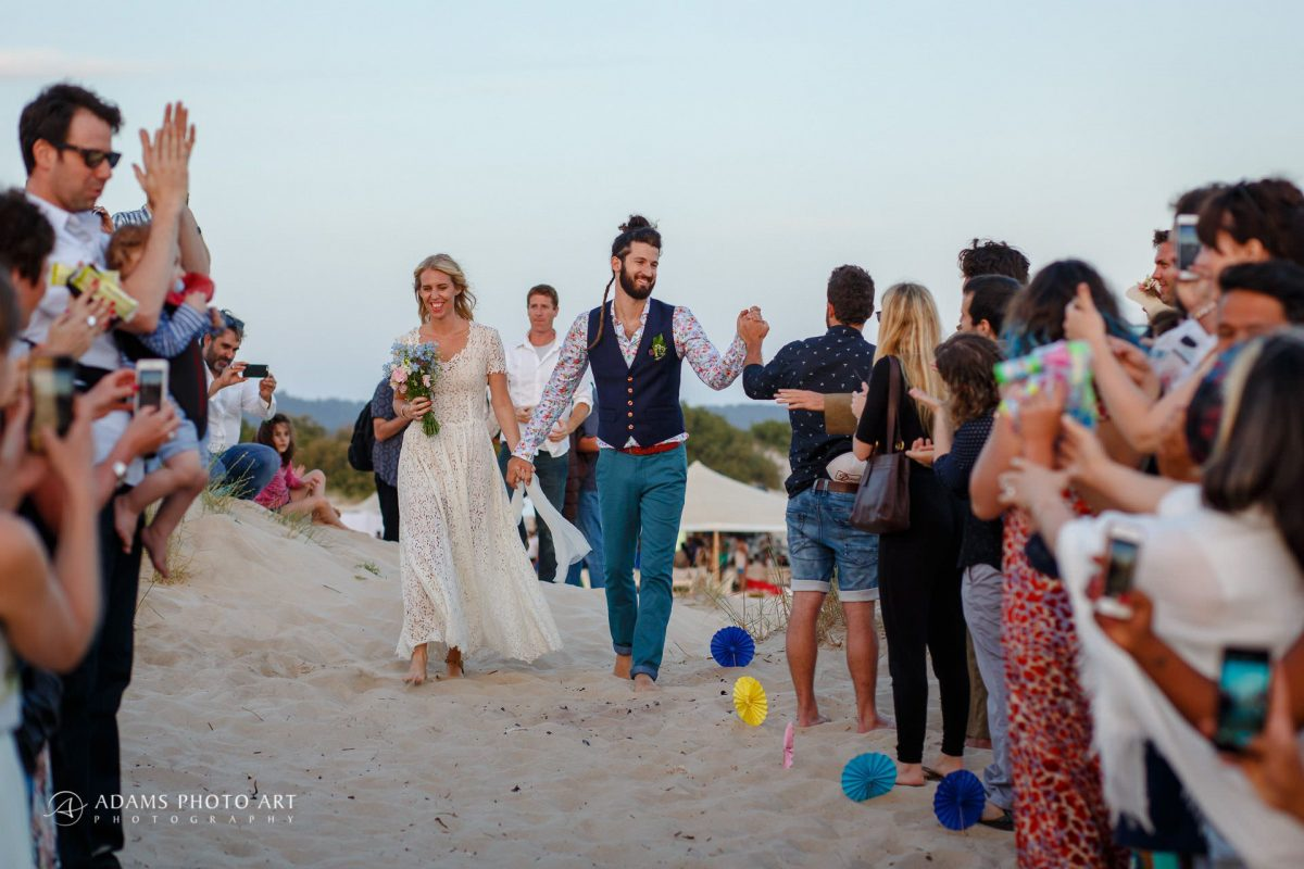 the loving couple walking together for their ceremony on the beach wedding