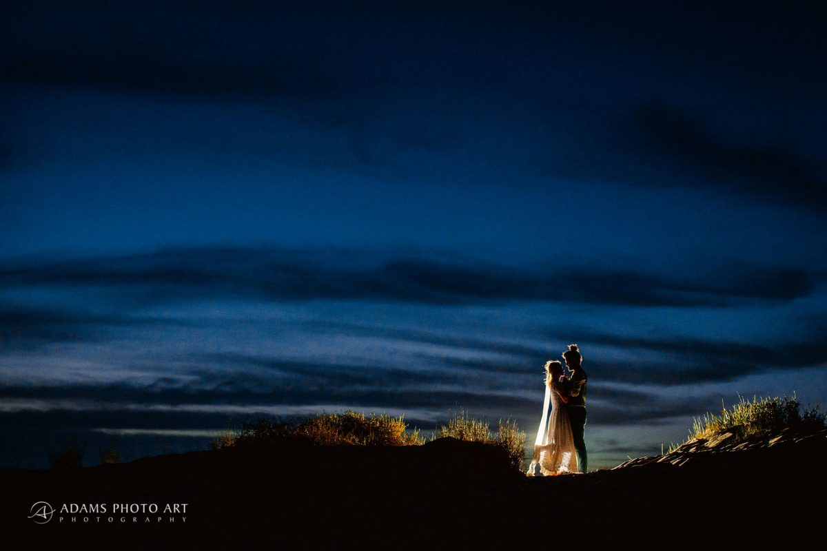 married couple posing after the sunset