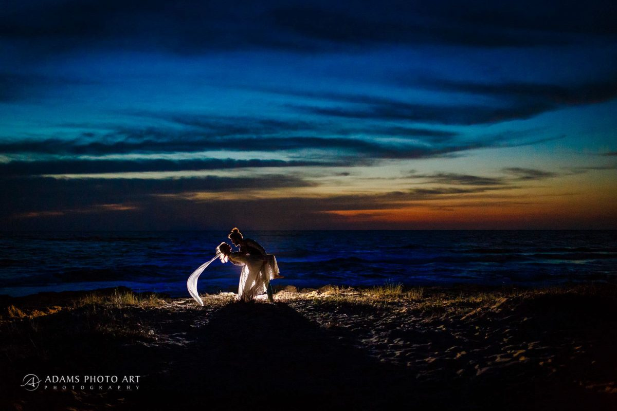 destination wedding photography after the sunset with the married couple posing in a deep