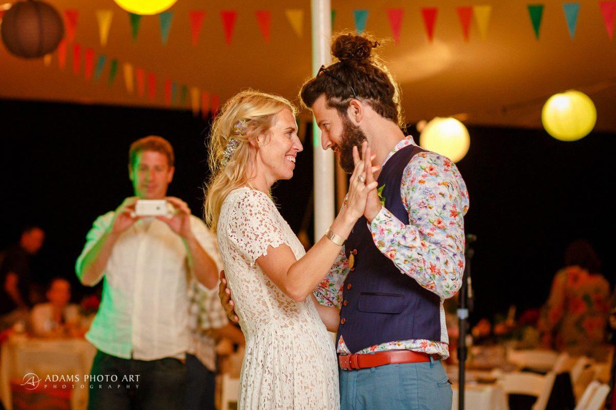 young couple dance on their destination beach wedding