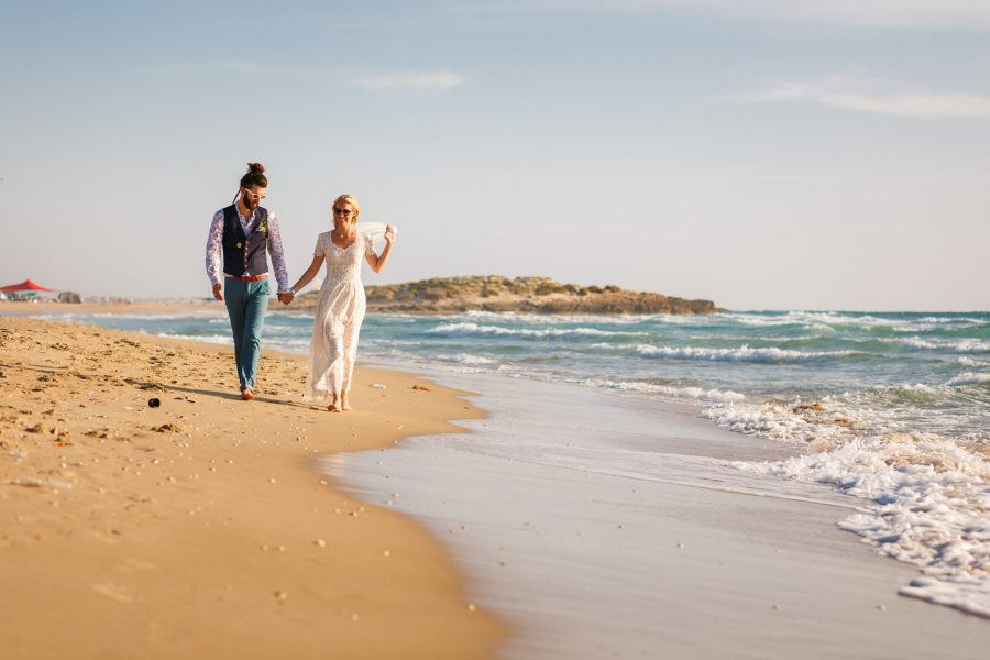 beach wedding Israel couple walking by the sea