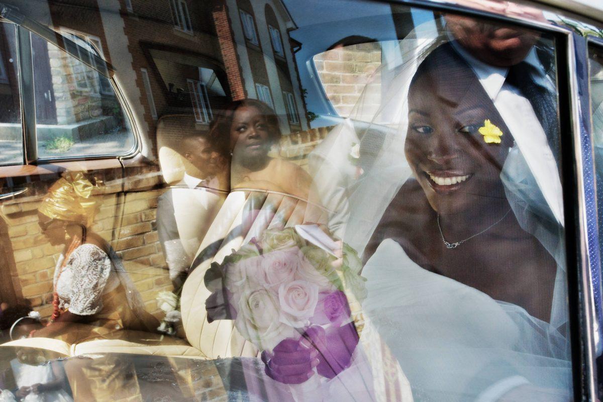 smiling bride in the car the photographer album