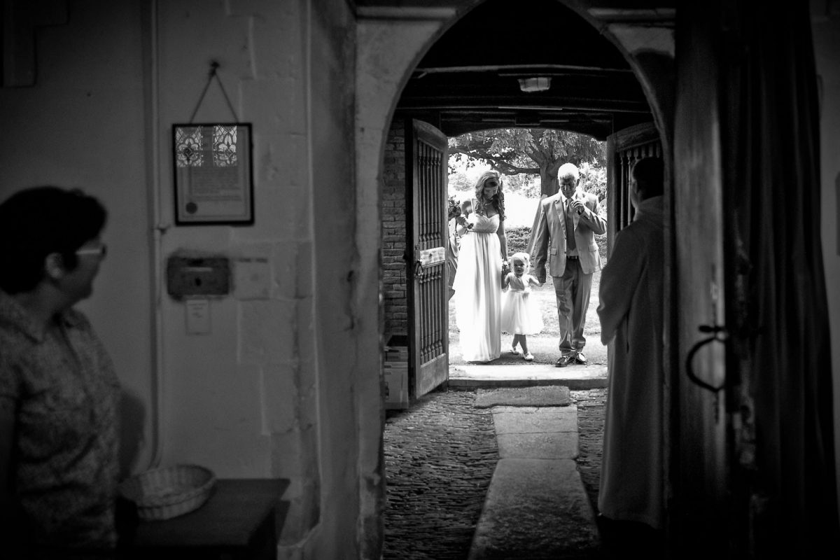 black and white picture of the married couple and little girl from portfolio of photographer for wedding