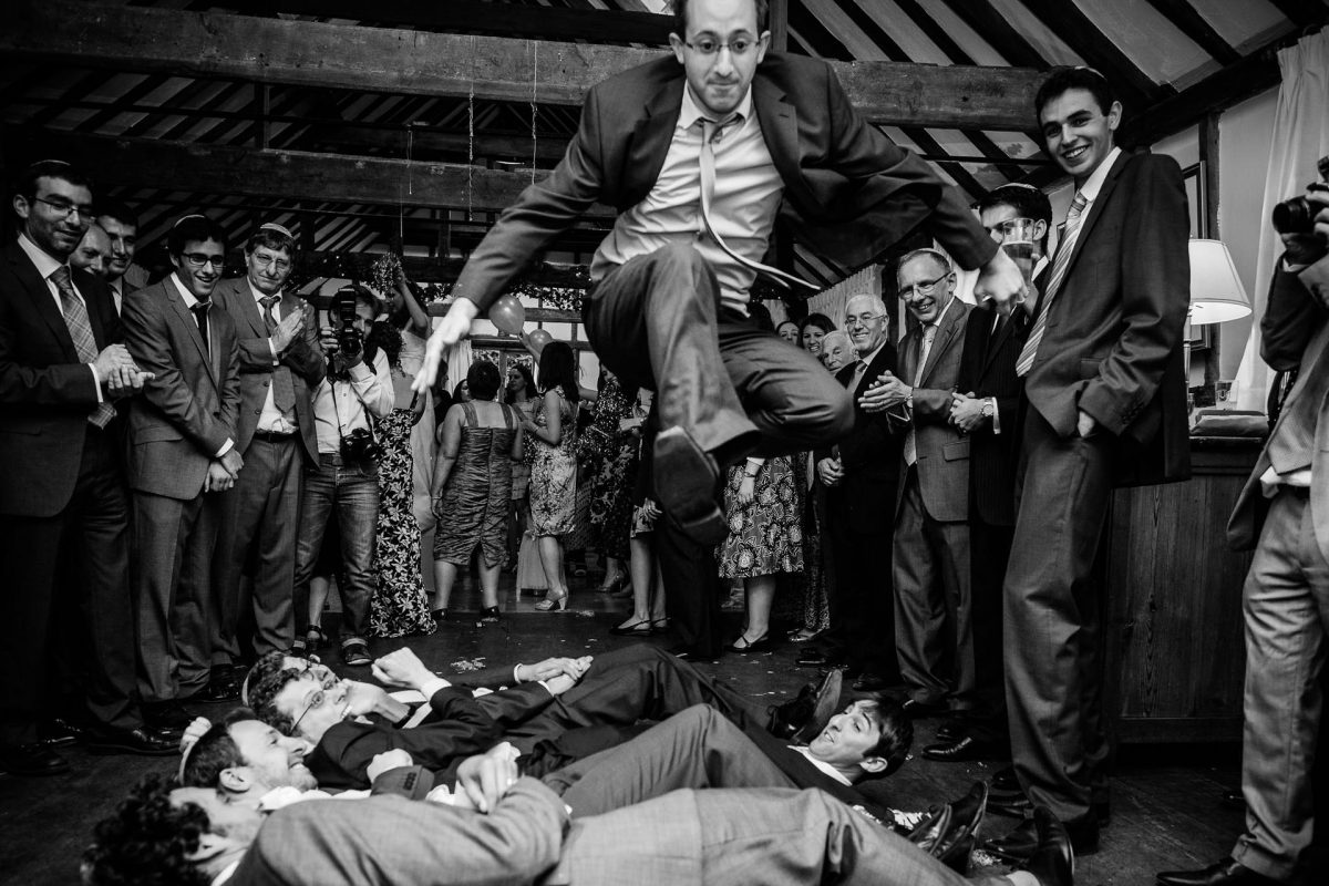 people play games at the wedding the black and white photography from london wedding photographer