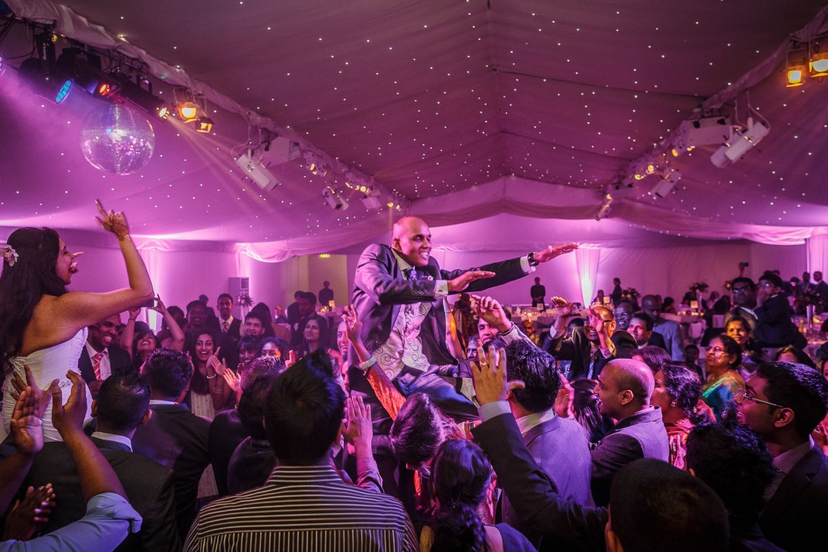 groom dancing at his london wedding party