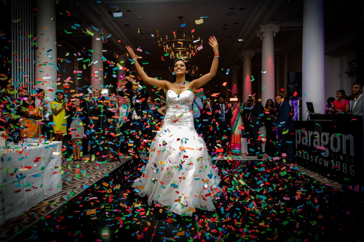 bride throwing confetti at her london wedding party