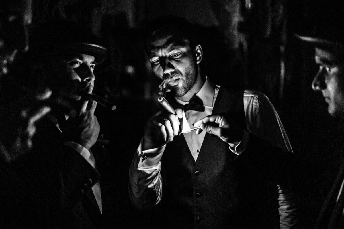 black and white photography of men at the wedding in london
