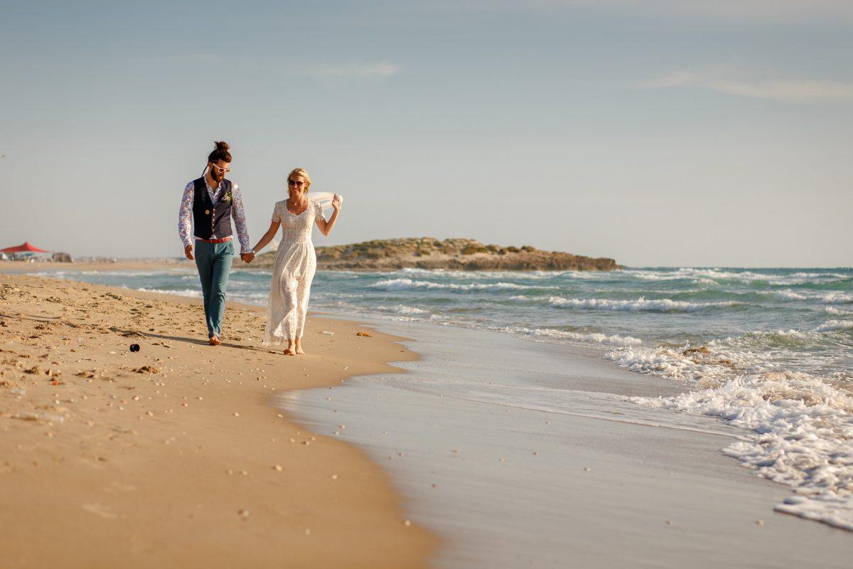 married couple on the beach the destination wedding portfolio of adam