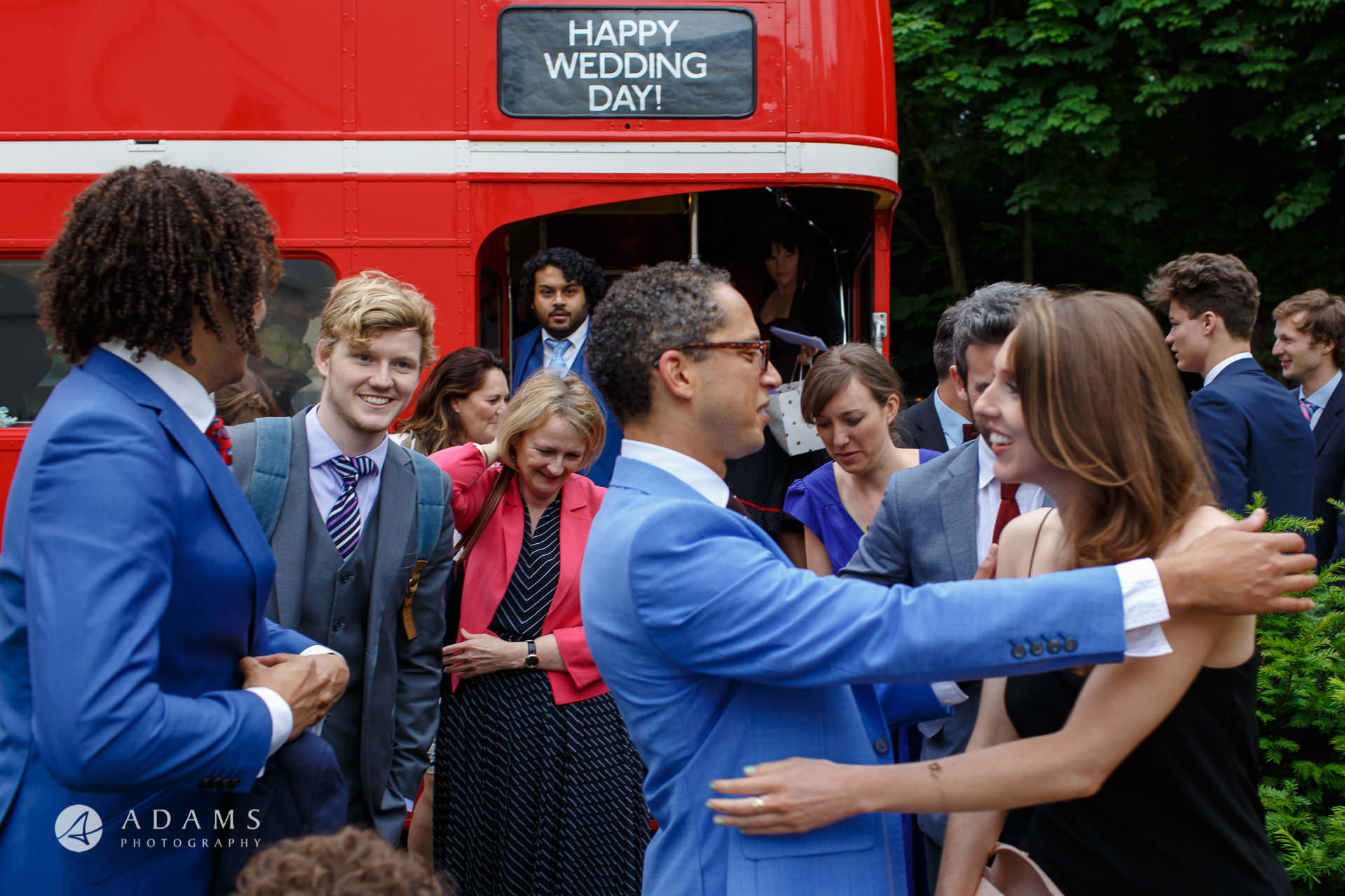 guest arrive in a red bus to Morden Hall