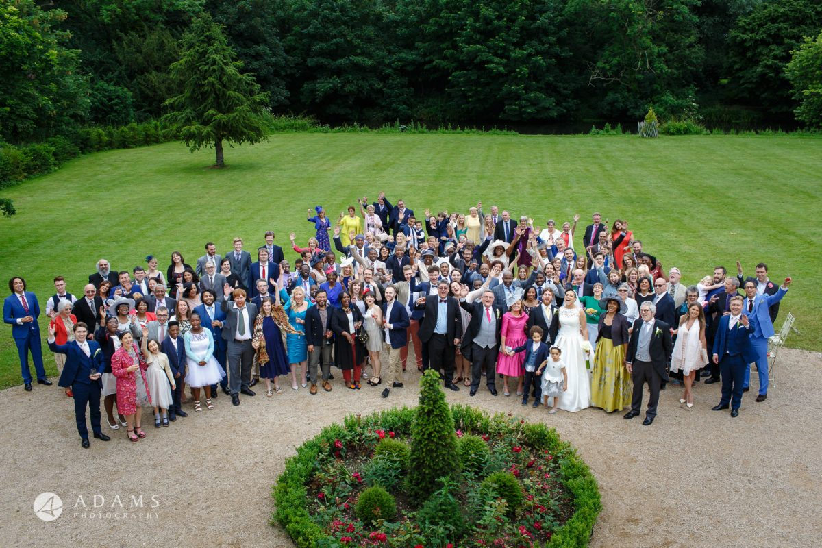 group shot of a wedding party at Morden Hall wedding by photographer