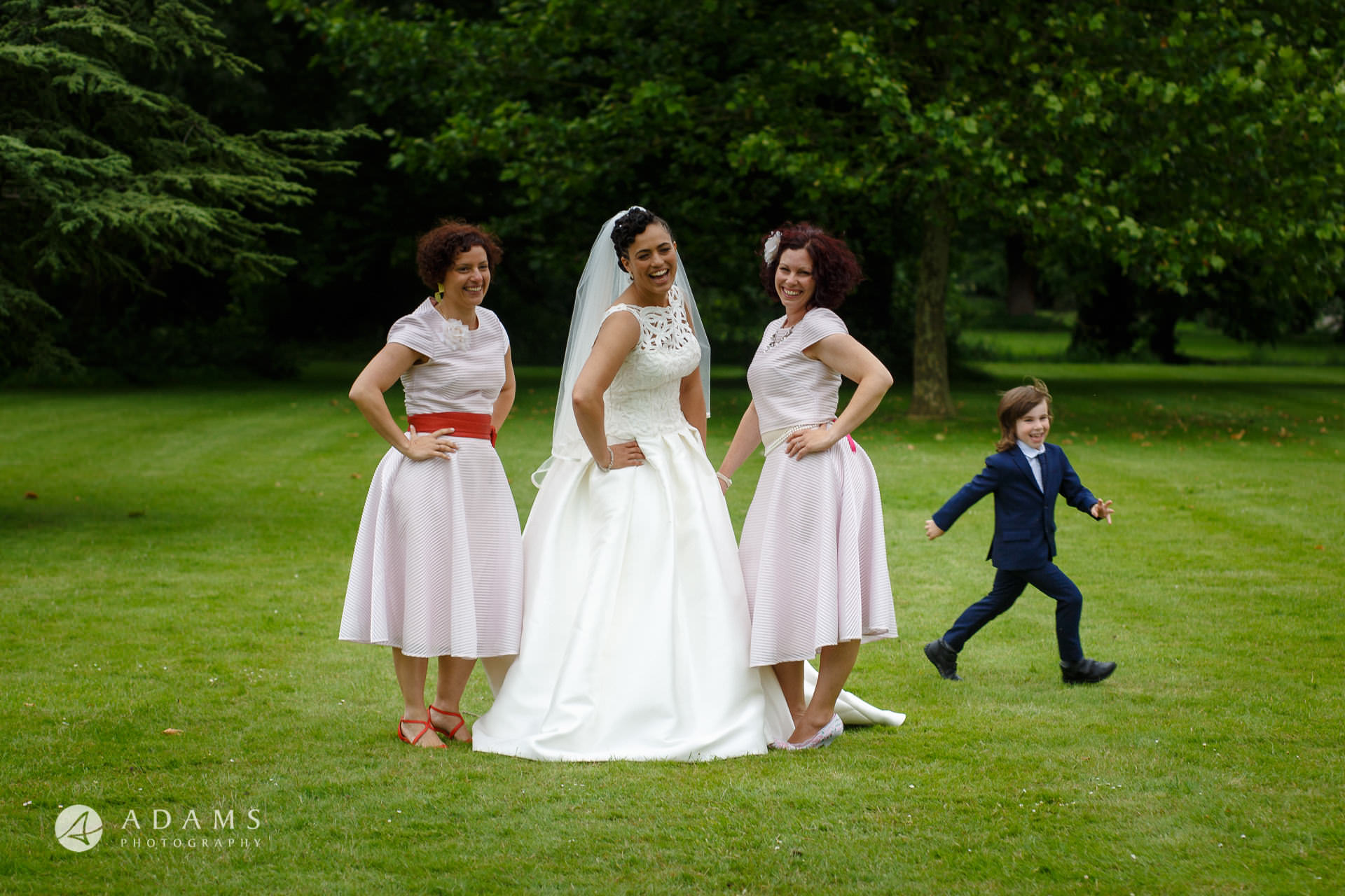 bride and bridesmaids are posing at Morden Hall