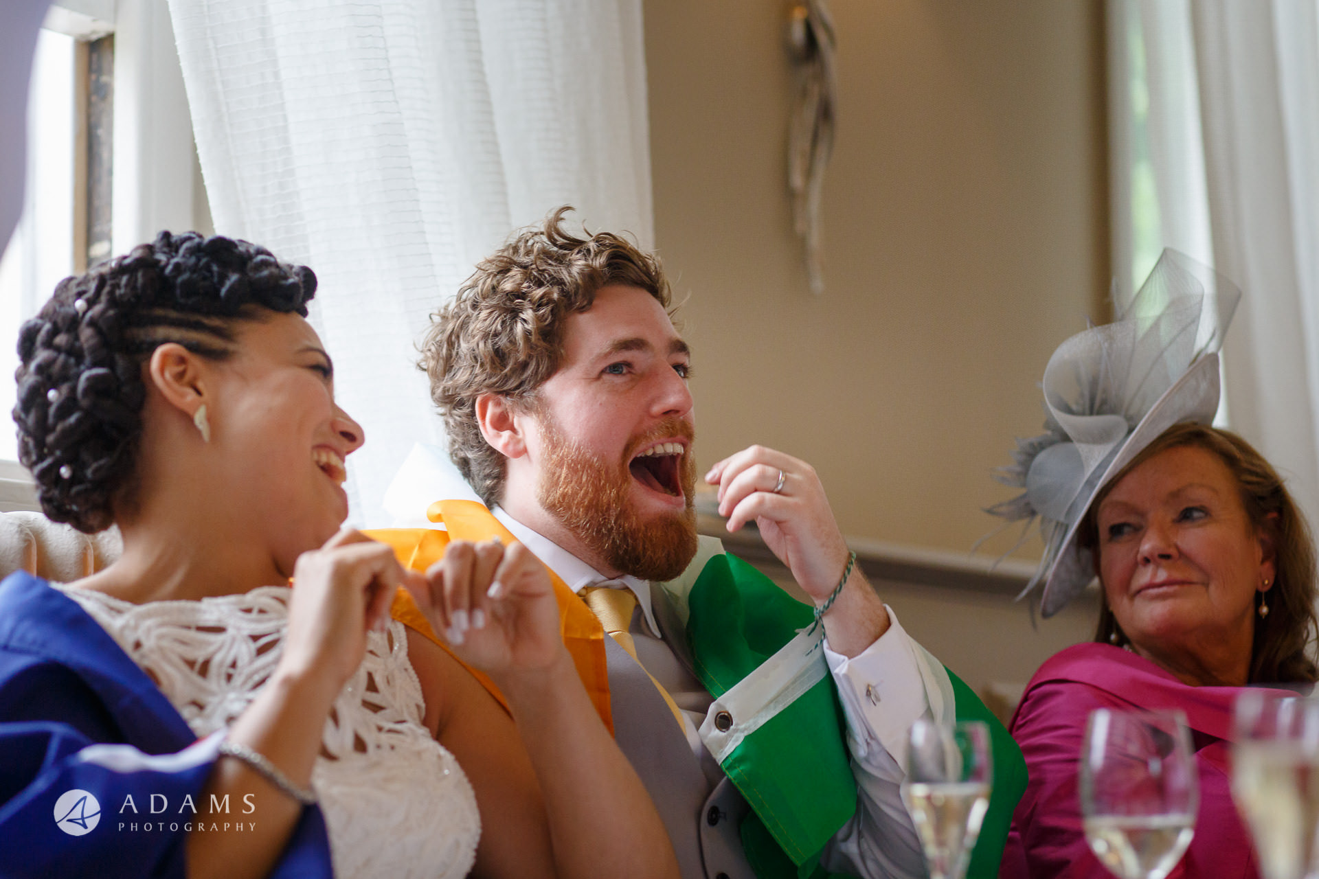 groom is laughing during the speeches at Morden Hall
