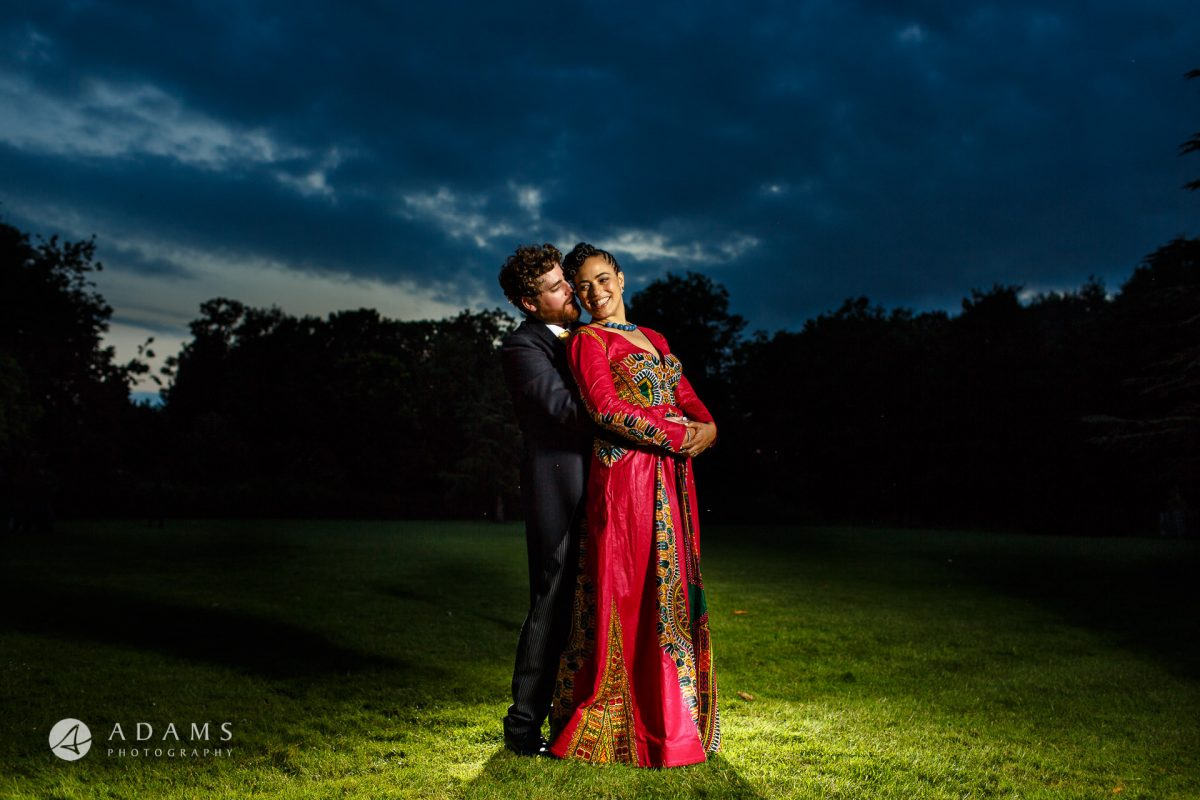 beautiful portrait of a bride and groom in the evening light at Morden Hall wedding by a photographer from Lonond