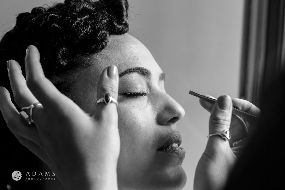 a portrait of a bride getting make up done by wedding photographer