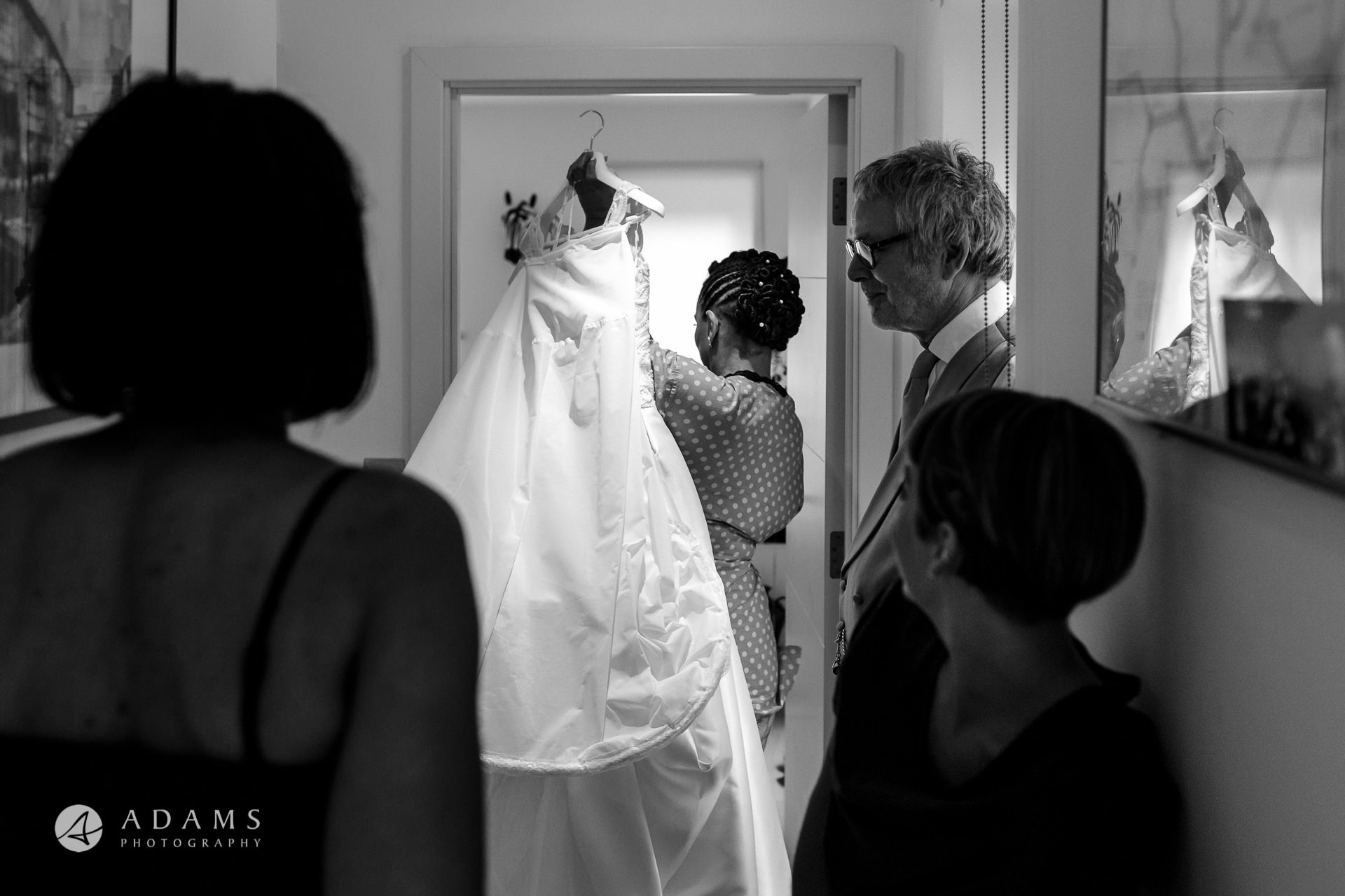 a bride is carrying her wedding dress