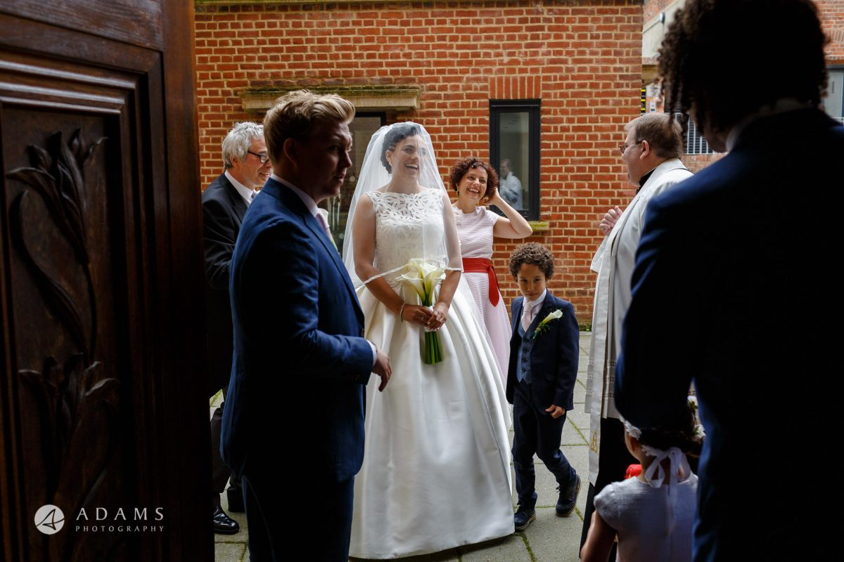 bride is standing by the door at st mary of eton church hackney wick