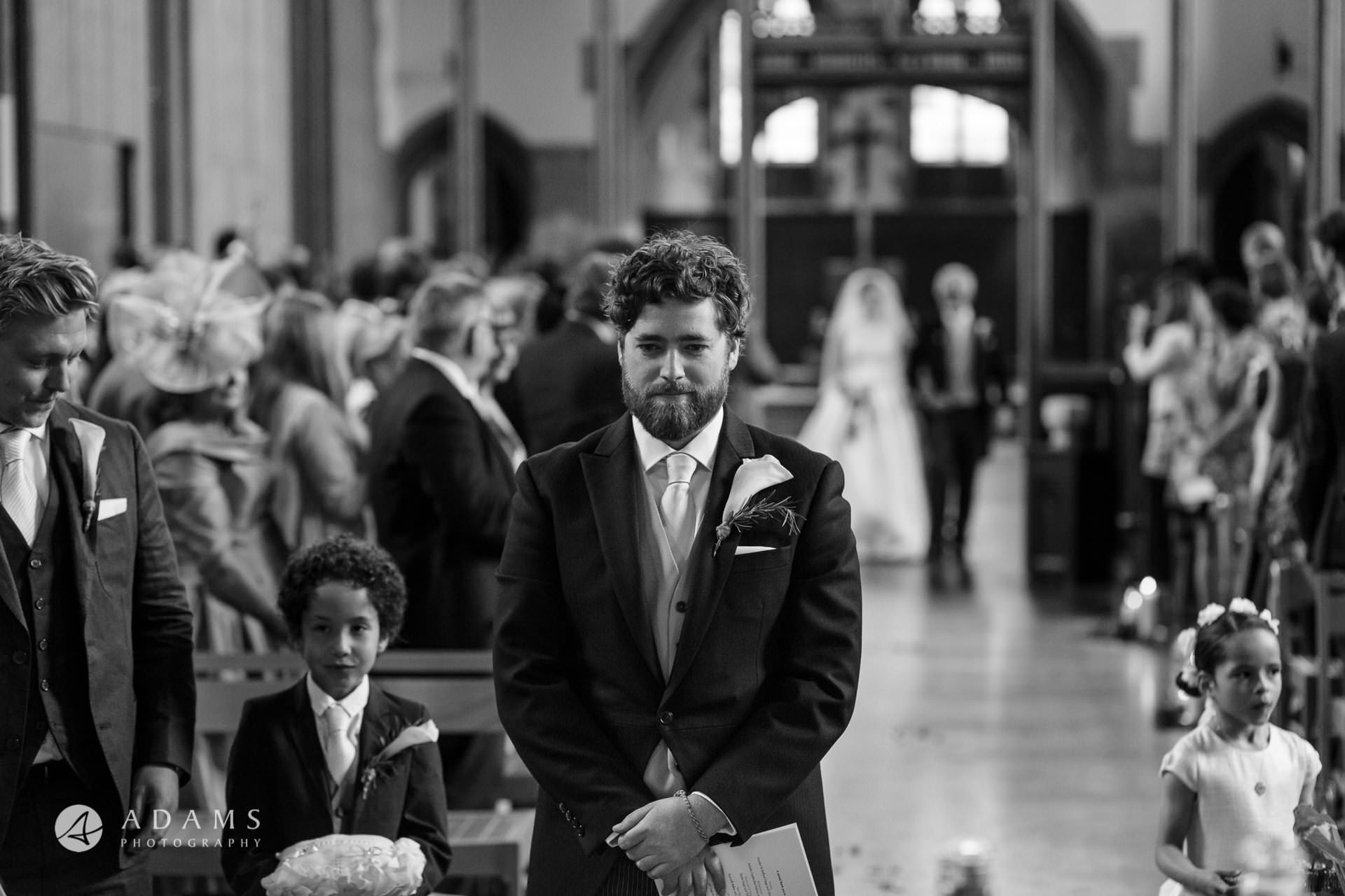 groom is waiting for his bride in st mary of eton church hackney wick