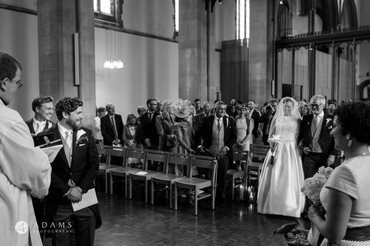 groom and the bride have their first look iat st mary of eton church hackney wick