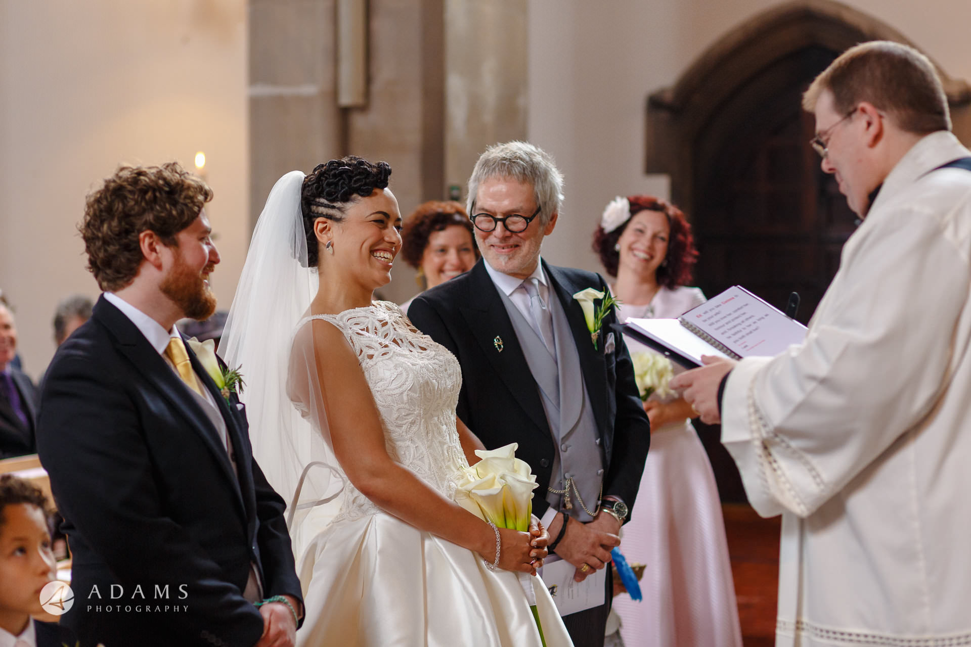 bride is smiling at st mary of eton church hackney wick