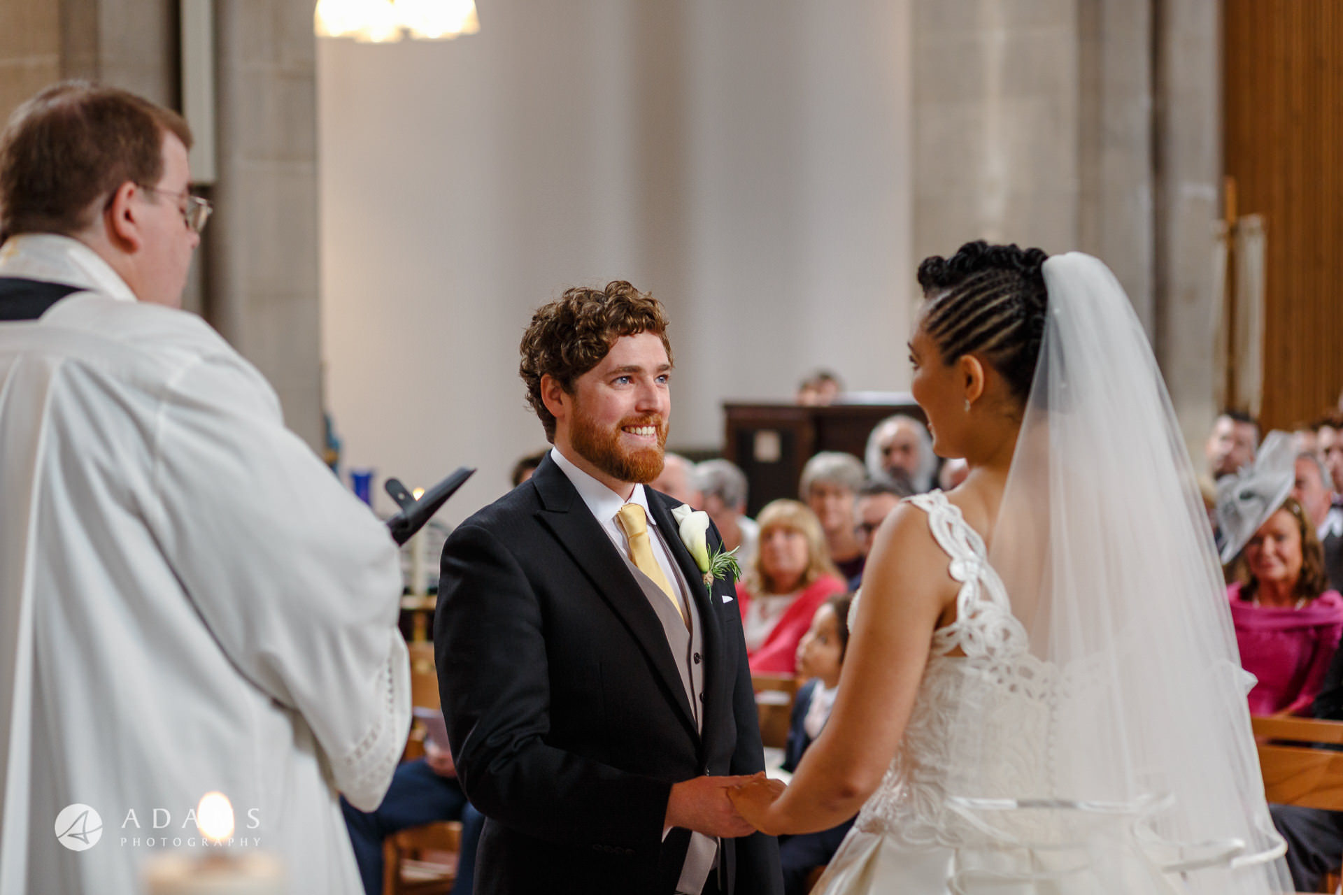 groom is looking into the brides eyes during the wedding ceremony at st mary of eton church hackney wick